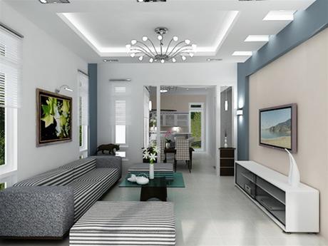 Không gian phòng khách được ngăn hờ với khu vực bếp bằng một vách ngăn nhẹ, tạo sự thông thoáng và rộng rãi cần thiết cho căn nhà